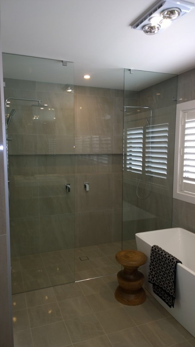 custom frameless shower screen double sky high glass