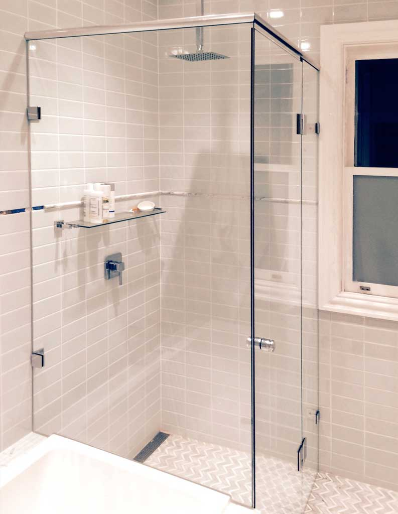 Semi-frameless glass shower enclosure